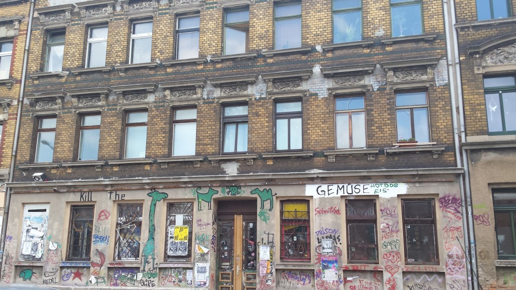 This is what I meant by 'buildings riddled with graffiti'. This building is in use and people can go there to eat.