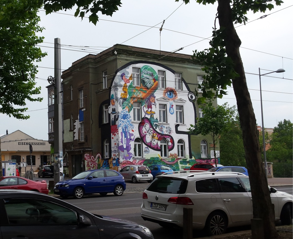 This is one example of where a group has been commissioned to decorate the facade of the building. The small white square on the bottom right hand side lists the contributing artists.